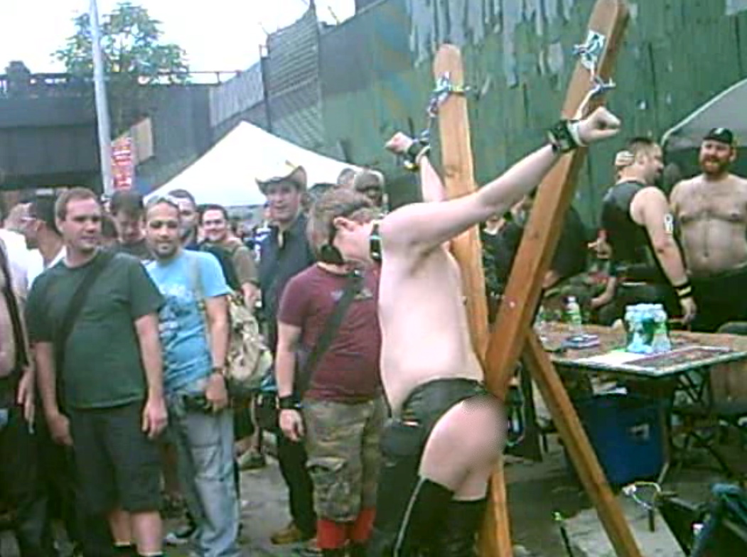 folsom-east-2009_tasered-guy-writhing_genital_nudity_covered.jpg