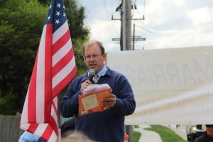 "AFTAH's Peter LaBarbera speaking at IFI rally against homosexuality-based ""marriage."" He is holding a ""children's"" book, ""King & King,"" that promotes same-sex ""marriage"" to innocent children. The book is about a prince who ""marries"" another prince, rather than a princess. A man disrupted the speech, yelling out to LaBarbera and asking if he wanted to ""round up"" homosexuals and put them in camps."