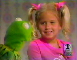 Chastity Bono as an innocent little girl with Kermit the Frog.