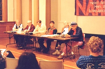 "Photo from the NAMBLA website of the late ""gay"" icon Harry Hay speaking at a 1984 meeting of the North American Man/Boy Love Association. Hay says ""gay"" boys benefit from sexual relationships with adult homosexual men."
