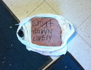 "Paver brick with threatening message, ""Shut down Lively,"" that was thrown through the glass door of Christian Liberty Academy, the morning of AFTAH's banquet at CLA in 2011. Obama's Justice Dep't has taken no public action against the perpetrators of this ""hate crime."""