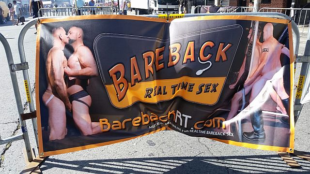 "A seller of condomless ""barebacking"" porn has a banner at one of the entrances of Up Your Alley. The Centers for Disease Control (CDC) strongly urges condom use for ""men having sex with men"" to prevent HIV--but many ""gay"" men ignore the CDC guidelines."