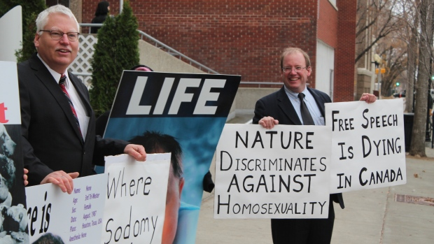 "Is  Biblical Truth ""Hate Speech"" in Canada: Canadian pro-family hero Bill Whatcott (left) and AFTAH's Peter LaBarbera (right) hold signs testifying to the truth about homosexuality and abortion--and Canada's repressive ""hate speech"" laws--prior to the trial Thursday at the Provincial Court in Regina, Saskatchewan."