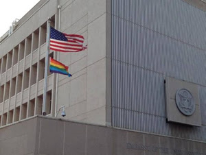 "Homosexual activist ""rainbow flag"" flies beneath Old Glory at the U.S. Embassy in Tel Aviv, Israel."