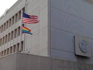 "Homosexual activist ""rainbow flag"" flies beneath Old Glory at the U.S. Embassy in Tel Aviv, Israel."