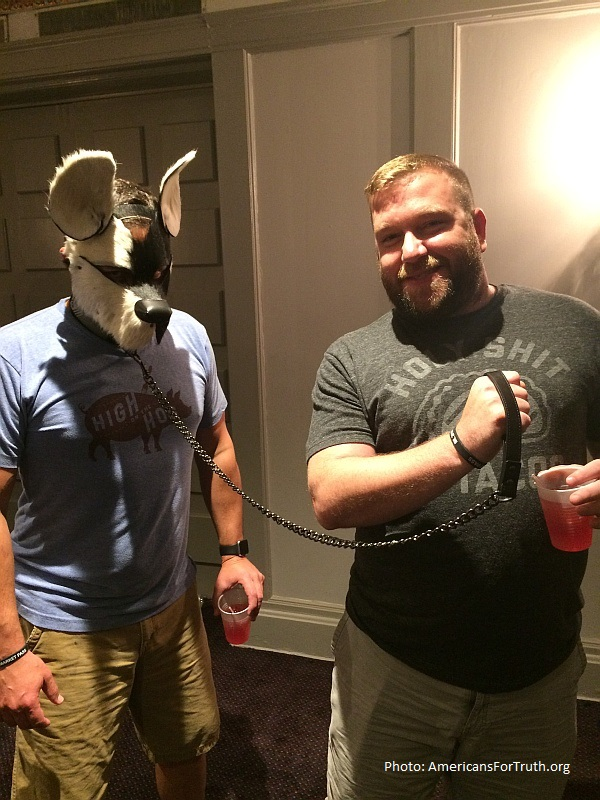 "Paganism: Man with his ""puppy"" on a leash poses for photo at International Mr. Leather in Chicago. What could be more degrading than men disassociating themselves from their own humanity?"